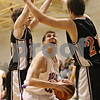 Rob Winner – rwinner@shawmedia.com<br /> <br /> Hinckley-Big Rock's Mitchell Hemesath (center) looks to shoot as Elgin Academy's Spencer Schael (left) and Connor Flexman defend in the first quarter of a Class 1A Hinckley Regional semifinal on Wednesday. H-BR defeated Elgin Academy, 75-40.