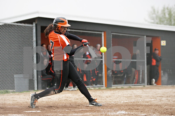 Rob Winner – rwinner@shawmedia.com<br /> <br /> DeKalb batter Jessica Townsend drives in a run with a single to left field during the bottom of the fourth inning Friday in DeKalb. DeKalb defeated Streamwood, 10-0, in six innings.