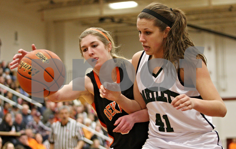 Rob Winner – rwinner@shawmedia.com<br /> <br /> DeKalb's Courtney Bemis (left) and Bartlett's Lisa Palmer chase after a ball in the first quarter during the Class 4A Elgin Super-Sectional on Monday, February 27, 2012.