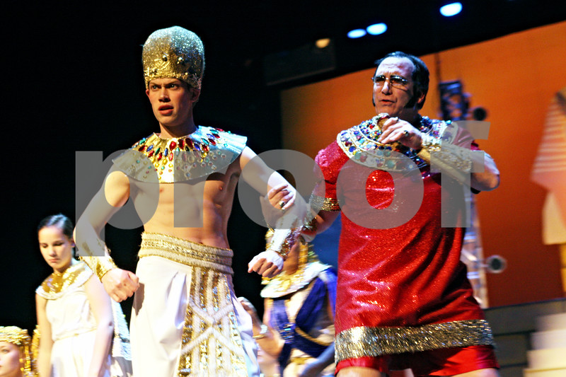 """Rob Winner – rwinner@shawmedia.com<br /> <br /> Jacob Austin (left), playing Joseph, and Andy Small, playing the Pharaoh, rehearse a scene from """"Joseph and the Amazing Technicolor Dreamcoat ,"""" at Northern Illinois University's O'Connell Theatre, Stevens Building on the DeKalb campus on Tuesday night. """"Joseph """" is being presented by CCT's Stage Right Theatre and will run Jan. 6-8 and 13-15 at the O'Connell Theatre."""