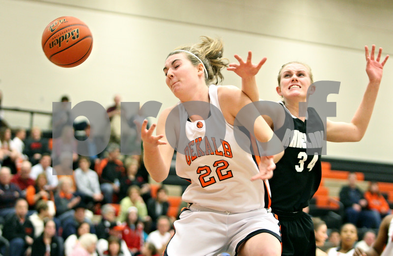 Rob Winner – rwinner@shawmedia.com<br /> <br /> Kaneland's Kelly Evers (34) disrupts a pass intended for DeKalb's Emily Bemis (22) during the first quarter in DeKalb on Tuesday, Jan. 31, 2012. DeKalb defeated Kaneland, 46-31.