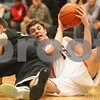 Kyle Bursaw – kbursaw@shawmedia.com<br /> <br /> DeKalb guard Brian Sisler finds somewhere to pass as he goes down to the floor while Sycamore players David Compher (left) and Rashaud Bomar (back) collide chasing after him in the second quarter. DeKalb defeated Sycamore 41-36 at DeKalb High School on Friday, Feb. 24, 2012.