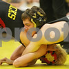 Rob Winner – rwinner@shawmedia.com<br /> <br /> Sycamore's Colton Burns (right) competes against Rock Island's Chase Wiggins during the 126-pound match in a Class 2A Sycamore Team Sectional semifinal on Tuesday, Feb. 21, 2012.