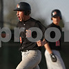 Rob Winner – rwinner@shawmedia.com<br /> <br /> DeKalb baserunner Trenton Sopko (9) reacts after scoring during the top of the fifth inning during the top of the second inning Thursday in Sycamore. DeKalb defeated Sycamore, 9-2.
