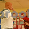 """Tess Moreno, 9, of DeKalb, practices hitting a mannequin and saying """"no"""" during a bully prevention workshop held Sunday at the Kishwaukee Family YMCA in Sycamore. Instructor Tom Scott, left, taught the class aimed at children ages 5 to 14.<br /> <br /> By Nicole Weskerna - nweskerna@shawmedia.com"""