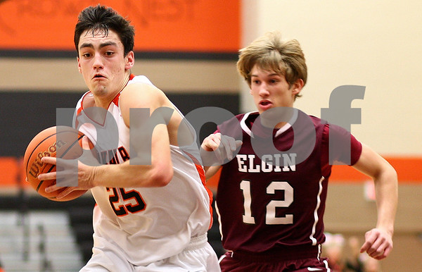 Kyle Bursaw – kbursaw@shawmedia.com<br /> <br /> DeKalb guard Kyle Berg makes his way to the basket with Elgin's Derek Strohmaier in pursuit in the second quarter of the game. Elgin defeated the Barbs 50-48 at DeKalb High School on Tuesday, Feb. 7, 2012.