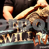 Kyle Bursaw – kbursaw@shawmedia.com<br /> <br /> One of Jack Hanna's crew members keeps a snapping turtle from making his way off of the table onstage during Hanna's 'Into the Wild Live' show at the Egyptian Theater in DeKalb, Ill. on Sunday, March 11, 2012.