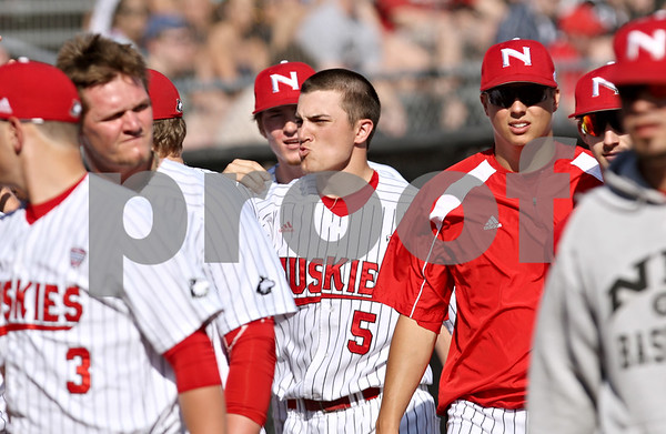 Rob Winner – rwinner@shawmedia.com<br /> <br /> Northern Illinois' Jordan Huffman (5) is greeted by his teammates after scoring in the second inning in DeKalb on Tuesday afternoon. Huffman drove in three runs in the second inning with a bases clearing double.