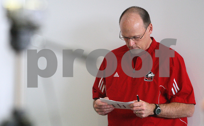 Kyle Bursaw – kbursaw@shawmedia.com<br /> <br /> Northern Illinois University defensive coordinator Jay Niemann reviews some notes while waiting his turn to answer questions from the media during a press conference at the Yordon Center in DeKalb, Ill. on Monday, March 26, 2012.
