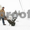 Rob Winner – rwinner@shawmedia.com<br /> <br /> Hinckley resident Patrick Sipp clears his driveway with a snow thrower on North View Street on Thursday afternoon.