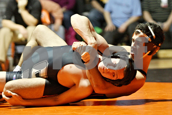 Rob Winner – rwinner@shawmedia.com<br /> <br /> Sycamore's Zach Munro (front) is controlled by DeKalb's Evan Jones during their 132-pound match in DeKalb on Thursday, Jan. 12, 2012.