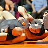 Rob Winner – rwinner@shawmedia.com<br /> <br /> Sycamore's Zach Munro (front) is controlled by DeKalb's Evan Jones during their 132-pound match in DeKalb on Thursday, Jan. 12, 2012.