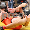 Kyle Bursaw – kbursaw@shawmedia.com<br /> <br /> Sycamore's Kyle Akins tries to escape the grasp of a Minooka wrestler during a 113-pound match in the Sycamore Invitational on Saturday, Jan. 7, 2012.