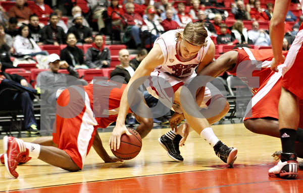 Rob Winner – rwinner@shawmedia.com<br /> <br /> Northern Illinois' Aksel Bolin loses possession of the ball during the first half in DeKalb on Wednesday, Feb. 8, 2012.