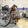 Rob Winner – rwinner@shawmedia.com<br /> <br /> Leomar Leyva of the Chicago Hornets prepares his chair before a wheelchair basketball game hosted by the Northern Illinois Presidential Commission on Persons with Disabilities and the Center for Access-Ability Resources at the NIU Student Recreation Center in DeKalb Thursday evening.
