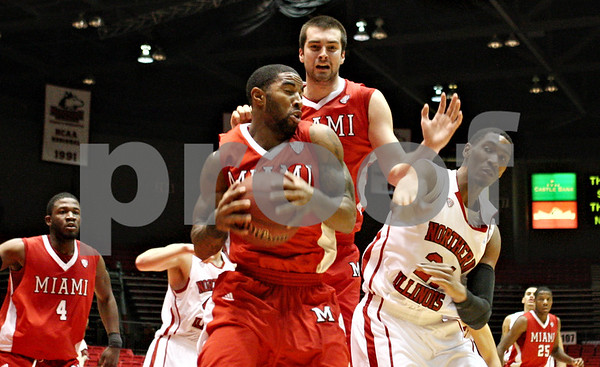 Rob Winner – rwinner@shawmedia.com<br /> <br /> Miami (Ohio) guard Quinten Rollins controls a rebound ahead of Northern Illinois forward Keith Gray (right) during the first half in DeKalb on Wednesday, Feb. 8, 2012.