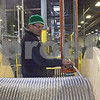 Juan Sangaeril guides aluminum wire onto a spool Monday at Nehring Electrical Works Company in DeKalb, which recently celebrated its 100th anniversary in business.<br /> <br /> By Nicole Weskerna - nweskerna@shawmedia.com