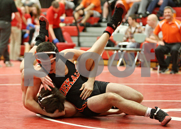 Rob Winner – rwinner@shawmedia.com<br /> <br /> DeKalb's Evan Jones (top) controls Yorkville's Jacob Hurt during the Northern Illinois Big 12 Conference tournament 132-pound quarterfinals in Ottawa on Saturday.