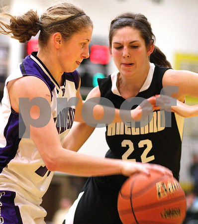 Kyle Bursaw – kbursaw@shawmedia.com<br /> <br /> Hampshire's Michelle Dumoulin drives past Kaneland's Brooke Harner during the second half at Sycamore High School on Monday, Feb. 20, 2012. Kaneland defeated Hampshire 40-31.