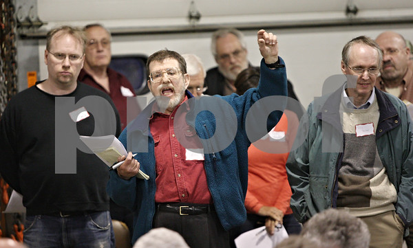 Rob Winner – rwinner@shawmedia.com<br /> <br /> Herb Rubin makes his remarks concerning DeKalb home rule during the annual DeKalb Township meeting Tuesday night.<br /> <br /> ***to the left of Rubin is Ted McCarron and to the right is Mayor Kris Povlsen -Rob***