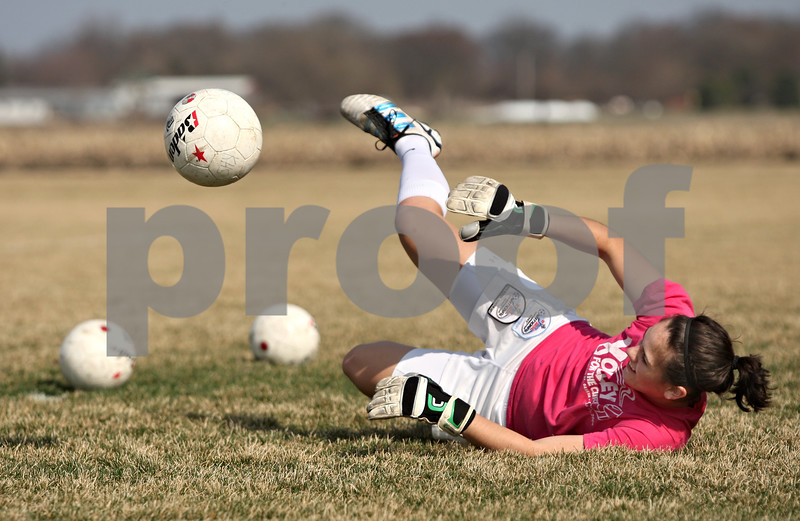 Rob Winner – rwinner@shawmedia.com<br /> <br /> Kaneland goalkeeper Jordan Ginther practices blocking in Maple Park on Friday, March 16.