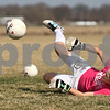 Rob Winner – rwinner@shawmedia.com<br /> <br /> Kaneland goalkeeper Jordan Ginther practices blocking in Maple Park on Friday, March 16.