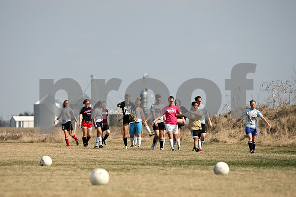 Rob Winner – rwinner@shawmedia.com<br /> <br /> The Kaneland girls soccer team begin their warmups at practice in Maple Park on Friday afternoon.