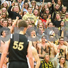 Kyle Bursaw – kbursaw@shawmedia.com<br /> <br /> Sycamore fans cheer on their team in the fourth quarter.<br />  DeKalb defeated Sycamore 41-36 at DeKalb High School on Friday, Feb. 24, 2012.