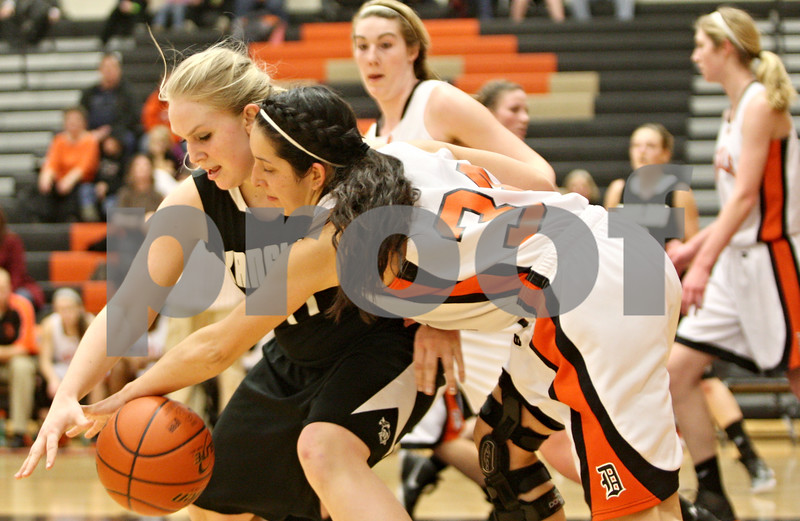Rob Winner – rwinner@shawmedia.com<br /> <br /> DeKalb's Rachel Torres (right) attempts to steal the ball from Kaneland's Ashley Prost during the second quarter in DeKalb on Tuesday, Jan. 31, 2012. DeKalb defeated Kaneland, 46-31.