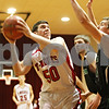 Rob Winner – rwinner@shawmedia.com<br /> <br /> Indian Creek's Andrew Hall (50) looks to shoot over North Boone's Dyle Koepp (right) during the first quarter in Shabbona on Tuesday night.