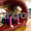 Kyle Bursaw – kbursaw@shawmedia.com<br /> <br /> Hazel Montavon, 4, crawls through part of an obstacle course at the NIU Motor Development Research Program on Wednesday, Feb. 22, 2012. The program has a Kinesiology class working with young children to develop their motor skills.