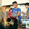 Rob Winner – rwinner@shawmedia.com<br /> <br /> Ashley Sorrentino hands over a bowl of chicken noodle soup that she filled for Noelle Sharp (left), 5 of Sycamore, during the Empty Bowls dinner at Northern Illinois University in DeKalb on Friday.