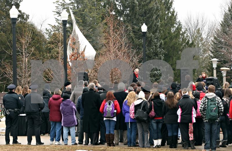 Rob Winner – rwinner@shawmedia.com<br /> <br /> February 14 memorial attendees listen to Northern Illinois University President John Peters on Tuesday afternoon in DeKalb.<br /> <br /> DeKalb, Ill.<br /> Tuesday, Feb. 14, 2012