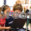 Kyle Bursaw – kbursaw@shawmedia.com<br /> <br /> West Elementary second-graders Nica Martinez (left) and Beau Cash work recording some poetry in class on Thursday, Jan. 26, 2012. Each student in McCormick's nearly paperless classroom has a hybrid tablet laptop computer.