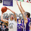 Kyle Bursaw – kbursaw@shawmedia.com<br /> <br /> Kaneland's Matt Limbrunner puts up a shot against the defense of Rochelle's David Newton during the fourth quarter. Kaneland defeated Rochelle 65-61at Rochelle Township High School on Friday, March 2, 2012. The regional championship is the first for Kaneland under third-year coach Brian Johnson.