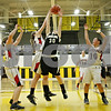 Rob Winner – rwinner@shawmedia.com<br /> <br /> Kaneland's Allyson O'Herron (30) has her shot blocked by Belvidere North's Anna Martensen (22) during the second quarter in a Class 3A Sycamore championship on Thursday, Feb. 23, 2012.