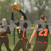 Rob Winner – rwinner@shawmedia.com<br /> <br /> DeKalb shortstop Jessica Townsend (7) catches a fly ball near the third baseline during the bottom of the fourth inning Tuesday in Sycamore. DeKalb defeated Sycamore, 1-0.