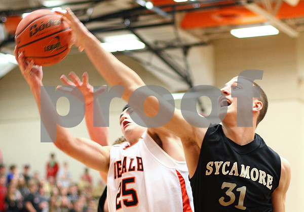 Kyle Bursaw – kbursaw@shawmedia.com<br /> <br /> DeKalb's Kyle Berg and Sycamore's Tom Paulsen go up for a rebound in the first quarter. DeKalb defeated Sycamore 41-36 at DeKalb High School on Friday, Feb. 24, 2012.