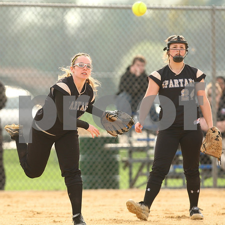 Kyle Bursaw – kbursaw@shawmedia.com<br /> <br /> Sycamore's Becca Schroeder delivers a ball to first base for an out after she and pitcher Taylor Zak (right) chased down a bunt at Sycamore Park on Friday, March 23, 2012.