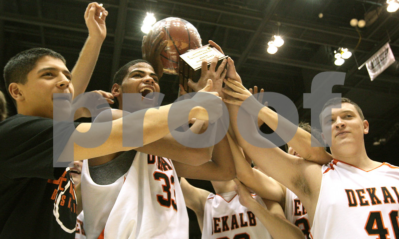 Kyle Bursaw – kbursaw@daily-chronicle.com<br /> <br /> The Barbs, including Andre Harris (center) and Tucker Code (right) hold up their trophy after defeating the Sycamore Spartans played their annual game at the Convocation Center on Friday Jan. 28, 2011.