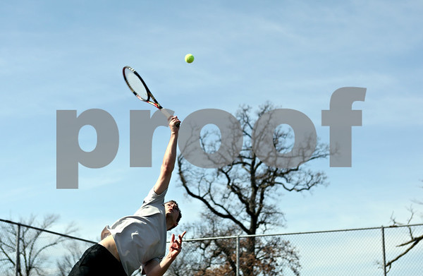 Rob Winner – rwinner@shawmedia.com<br /> <br /> Chris Frensley, of Kalamazoo, Mich., practices serving during a visit to Hopkins Park in DeKalb on Tuesday. Frensley, who just wanted to be outside and enjoy the weather, is in town visiting his girlfriend who attends Northern Illinois University.