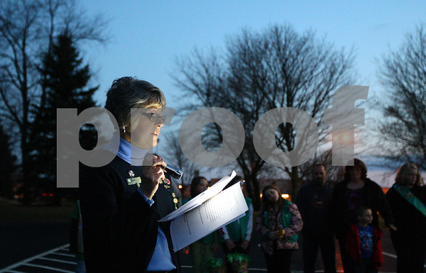 Kyle Bursaw – kbursaw@shawmedia.com<br /> <br /> Debi Frankovich, of the Sycamore Doubletree service unit, speaks to a gathering of more than 150 girl scouts and community members at a celebration of the girl scouts 100th birthday in the parking lot of Sycamore United Methodist Church on Monday, March 12, 2012.