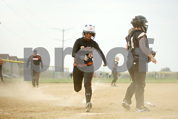 Rob Winner – rwinner@shawmedia.com<br /> <br /> DeKalb baserunner Sabrina Killeen (11) steps on home plate during the top of the sixth inning for the games' only run. DeKalb defeated Sycamore, 1-0.<br /> <br /> ***Crop to  your needs -Rob***
