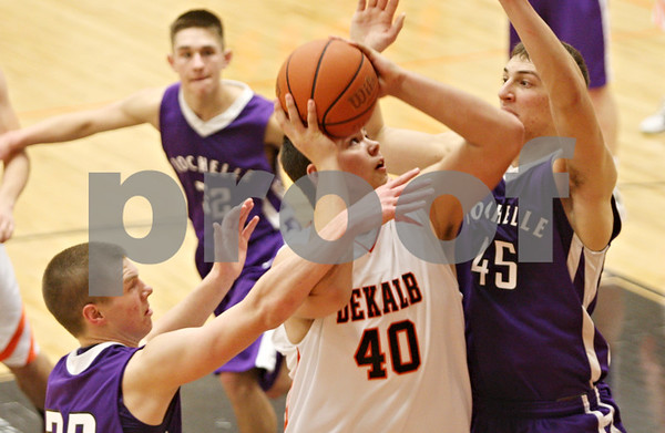 Rob Winner – rwinner@shawmedia.com<br /> <br /> DeKalb's Jake Smith (40) attempts a shot over Rochelle's David Newton (45) during the third quarter in DeKalb on Friday, Feb. 17, 2012. DeKalb defeated Rochelle, 69-67.