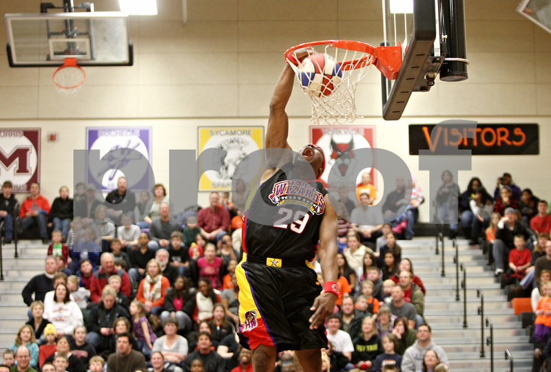 Rob Winner – rwinner@shawmedia.com<br /> <br /> Space Jam Leon Sewell of the Harlem Wizards slam dunks during an exhibition at DeKalb High School on Friday night. The game provided a night of family-friendly entertainment and it also served as a fundraiser for Clinton Rosette Middle School.