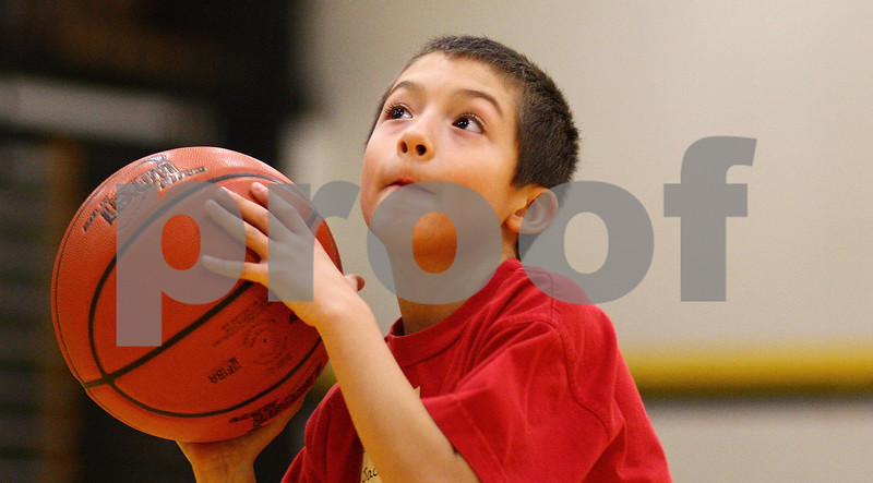 """Kyle Bursaw – kbursaw@shawmedia.com<br /> <br /> Jackson Lopez, 8, gets ready to attempt a free throw at Sycamore High School during the local round of the Elks National """"Hoop Shoot"""" Free Throw Contest on Saturday, Jan. 7, 2012."""
