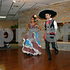ANDREW MITCHELL — amitchell@shawmedia.com<br /> Cousins Idalis (left) and Eric Garcia, of Sycamore and Genoa respectively, perform for dozens of Oak Crest DeKalb Area Retirement Center residents Sunday. The two are part of Mexican folkloric dance group, Rayitos del Sol of Conexion Comunidad.
