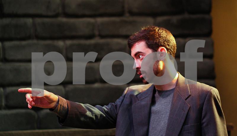 Kyle Bursaw – kbursaw@shawmedia.com<br /> <br /> Finbar (portrayed by Nick Ferrucci) talks to his drinking companions during a rehearsal of 'The Weir' on Tuesday, Jan. 24, 2012.