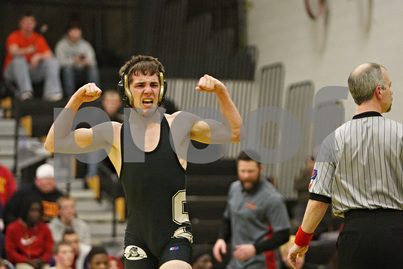 Rob Winner – rwinner@shawmedia.com<br /> <br /> Sycamore's Colton Burns celebrates a last-second takedown for a 6-4 decision that clinched the Spartans' win over Rock Island, 37-31, in a Class 2A Sycamore Team Sectional semifinal on Tuesday, Feb. 21, 2012.