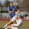 Rob Winner – rwinner@shawmedia.com<br /> <br /> Genoa-Kingston's Julia Mendoza (left) stops herself as Indian Creek's McKenzie Hackler and Sarah Schilling (bottom) collide during the second half in Waterman on Thursday, March 15, 2012. G-K defeated Indian Creek, 2-1.